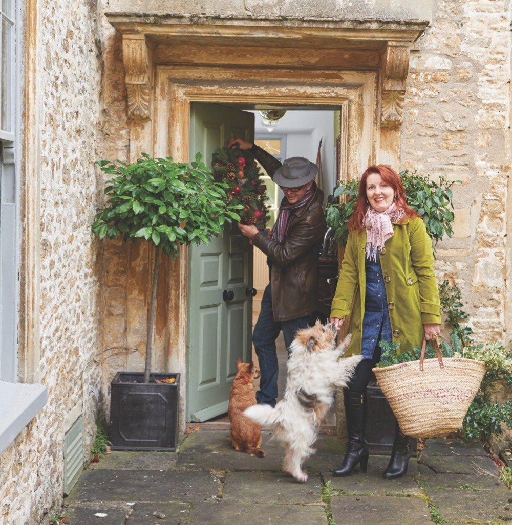 Antiques experts Lisa Lloyd and Marc Allum in front of their home