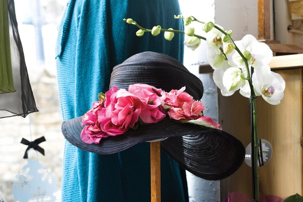 A vintage black hat with pink floral touches