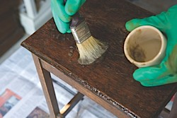 A table being covered with paint varnish