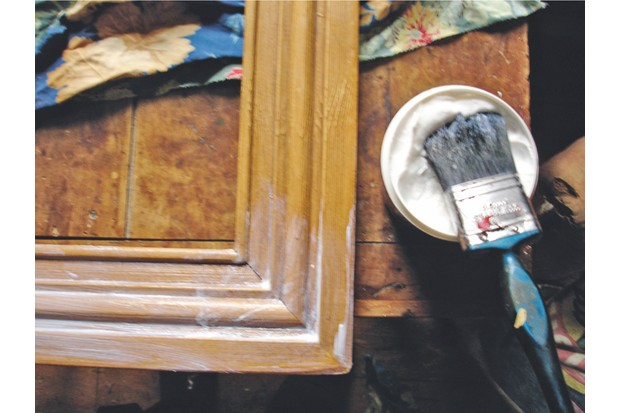 PVA wallpaper adhesive being added to a frame