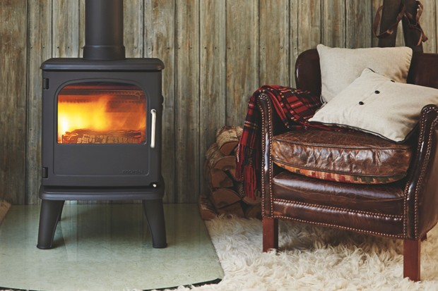 A wood-burning stove and leather armchair