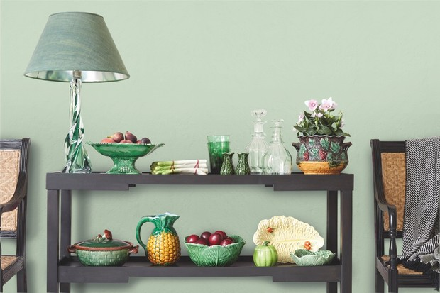 Ceramic fruit and vegetables on a sideboard