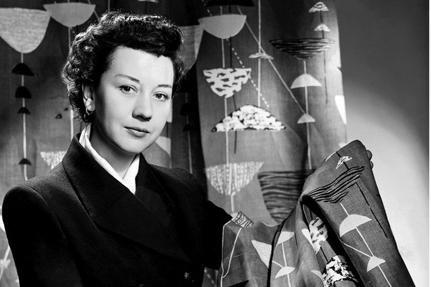 A picture of Lucienne Day holding her 'Calyx' pattern