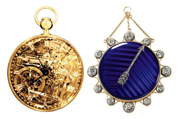 Two different pocket watches. One with a gold face and the other with a purple face