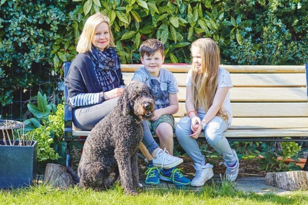 Interior designer Louise Convert with her two children and dog