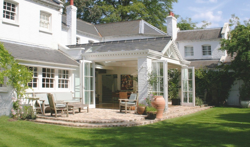 Folding sliding doors allow this orangery (from £40,000) by Malbrook to be completely opened up to the garders