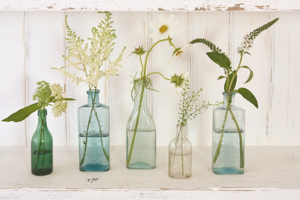Antique glass medicine bottles in various colours