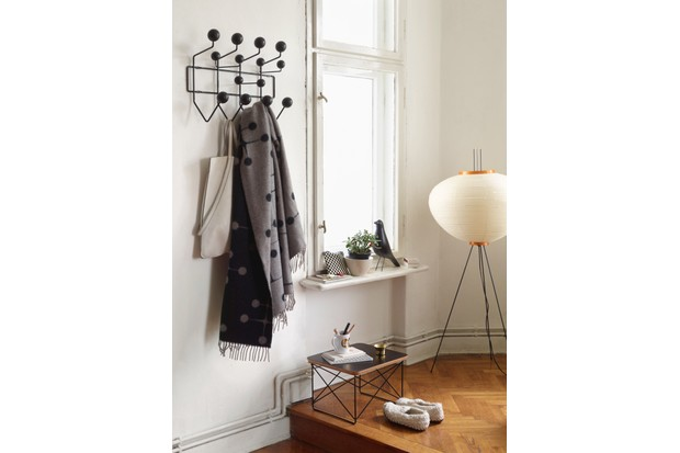 A black Eames Hang it All hanging with coats and scarves in a monochrome hallway