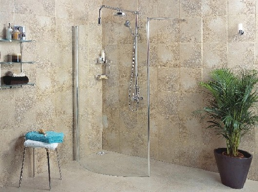 A shower in a wetroom enclosed by a single piece of glass
