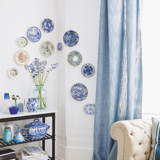 Rethink classic displays with this charming plate arrangement.
