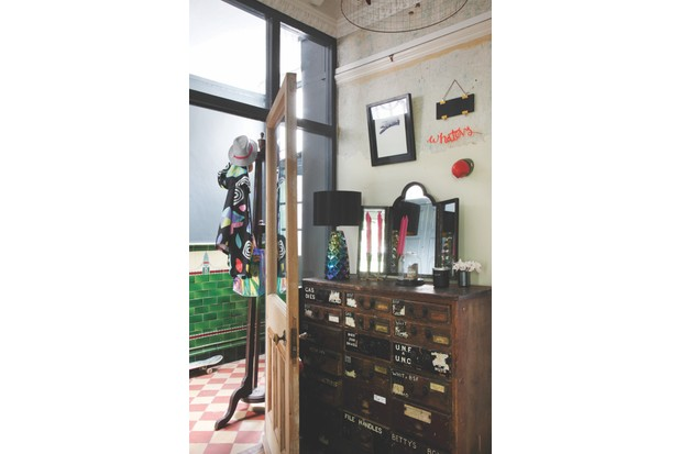 A vintage apothecary cabinet in Helen Ward's hallway