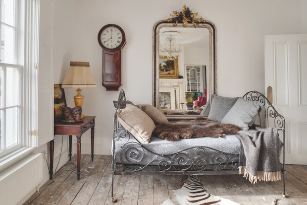 Antique furniture against a subtle, muted backdrop in a Somerset farmhouse