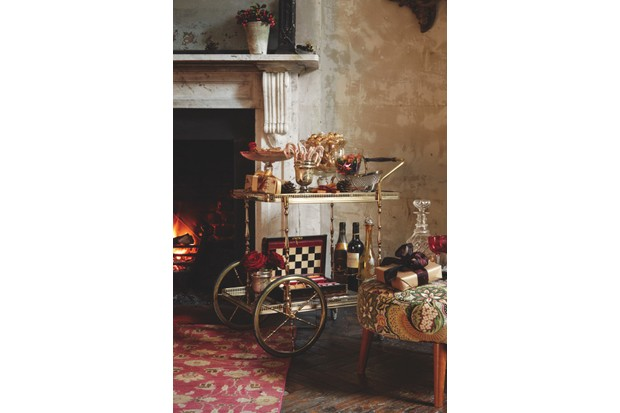 An antiques drinks trolley with glassware filled with sweets
