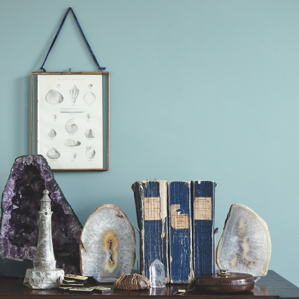 Antique books and crystals grouped on a vintage sideboard