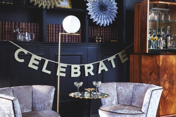 'Celebrate' party bunting hangs on a wall