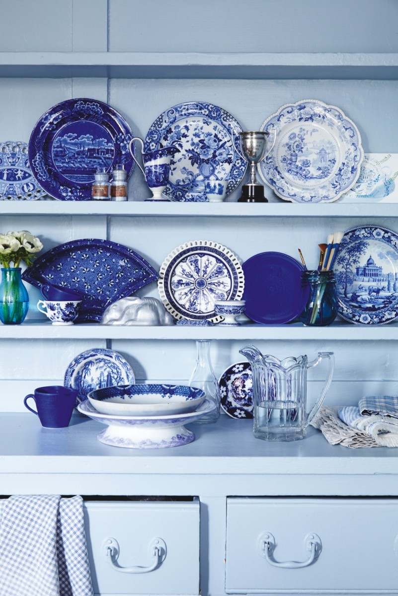 A collection of blue and white china on shelves