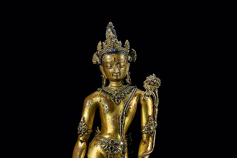 A 14th century bronze figure of Padmapani