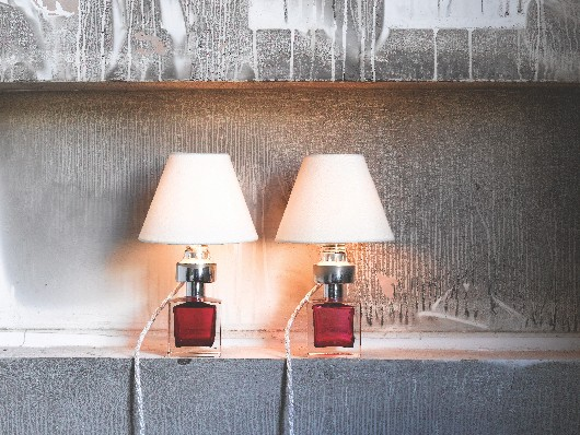 Vintage table lamps on a contemporary shelf
