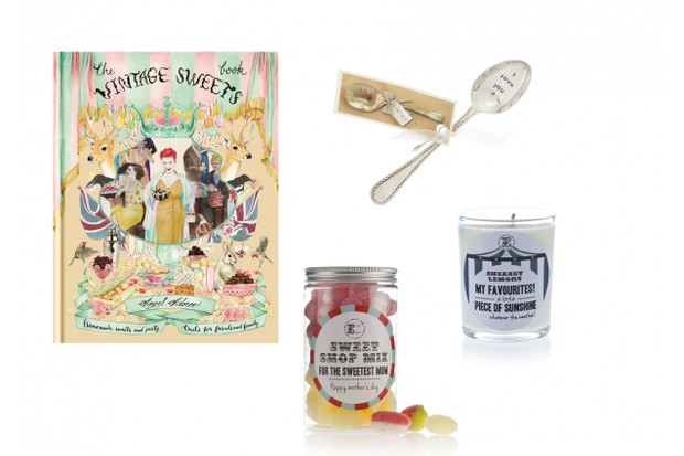 A 'Vintage Sweets' book next to a sweets jar, a teaspoon and a scented candle