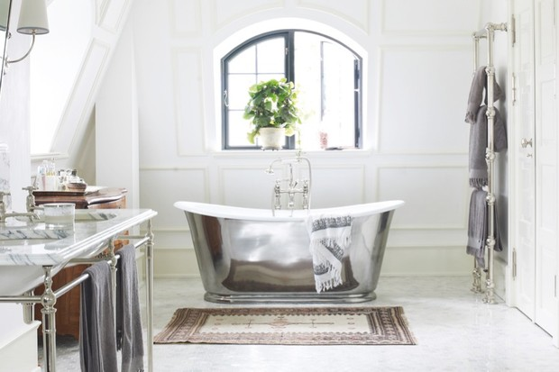 A freestanding cast iron bath with polished lacquer finish
