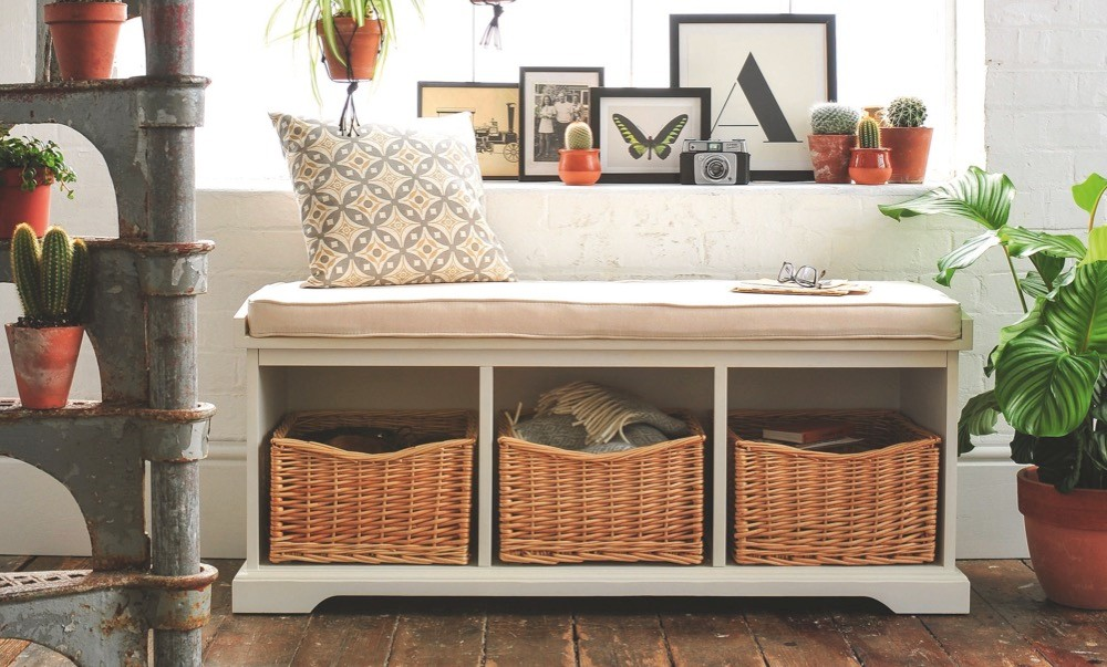 A hall bench with built-in storage space for fitted wicker baskets
