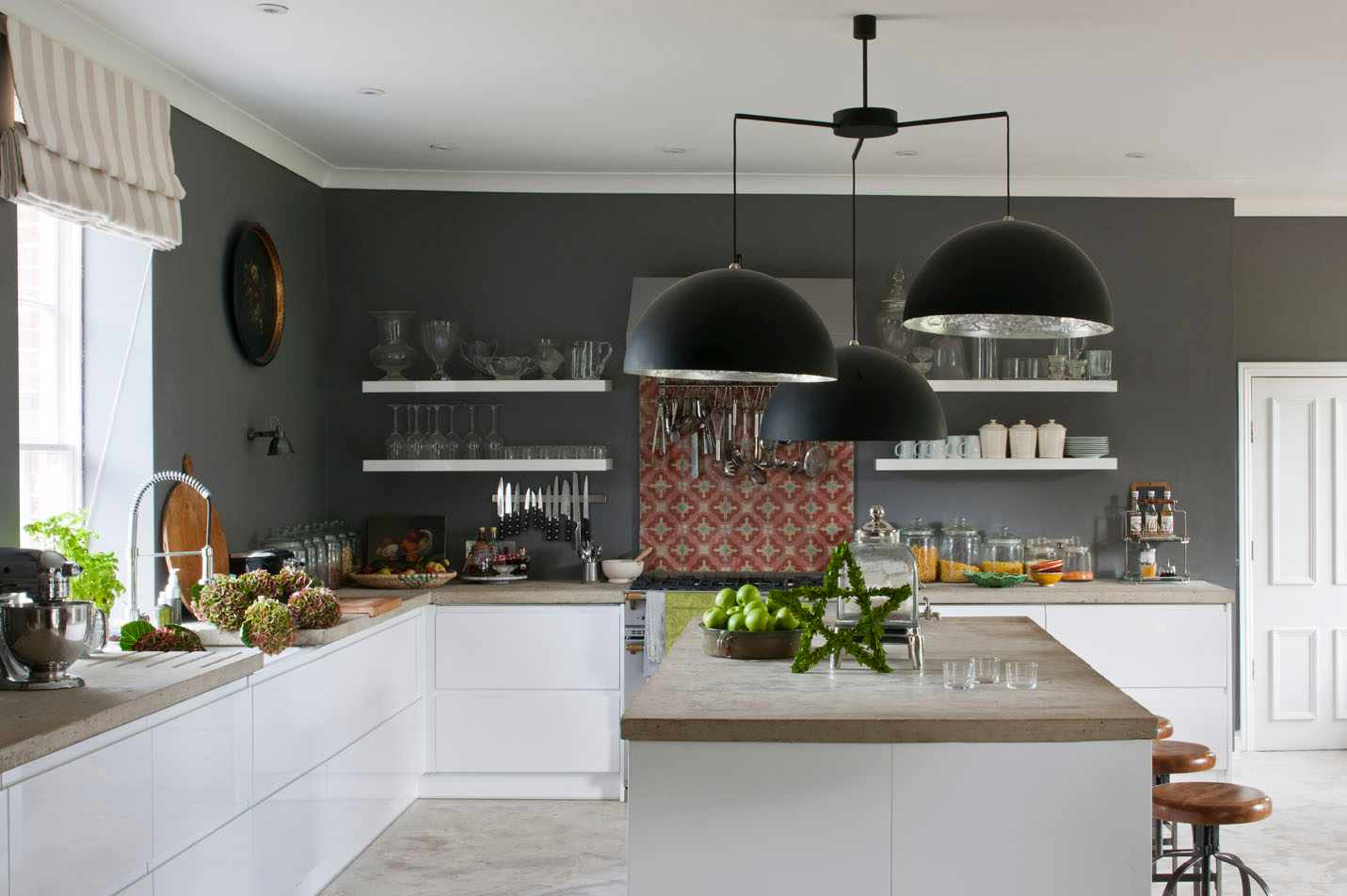 Spanish tiles from the Reclaimed Tile Company add interest to this kitchen