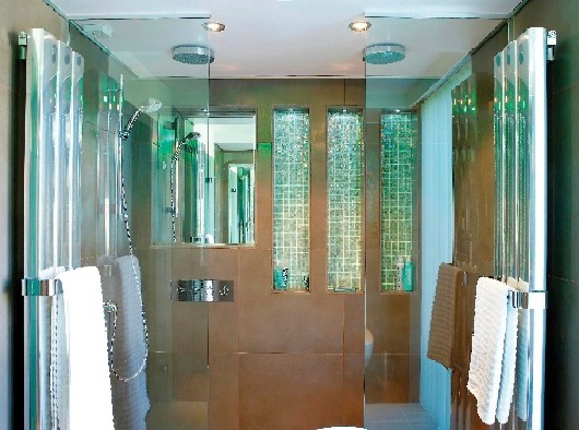 A shower with ceiling downlights