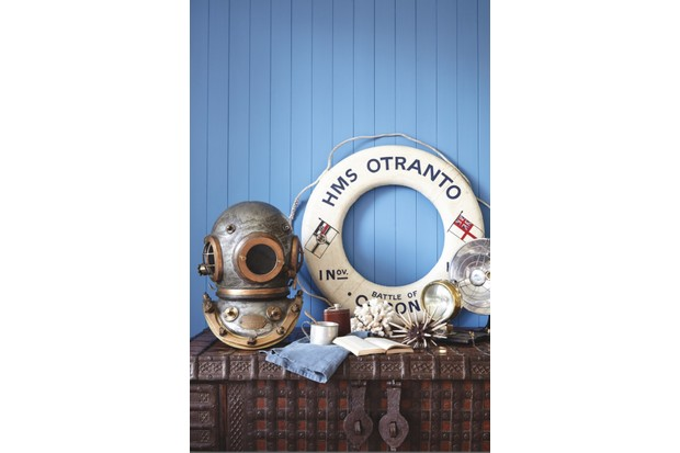 A collection of nautical themed decorations including an antique diver's helmet