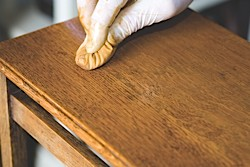 A French polish rubber is being used to polish