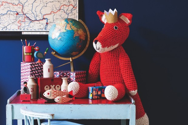 Folk-style children's gifts atop a child's desk
