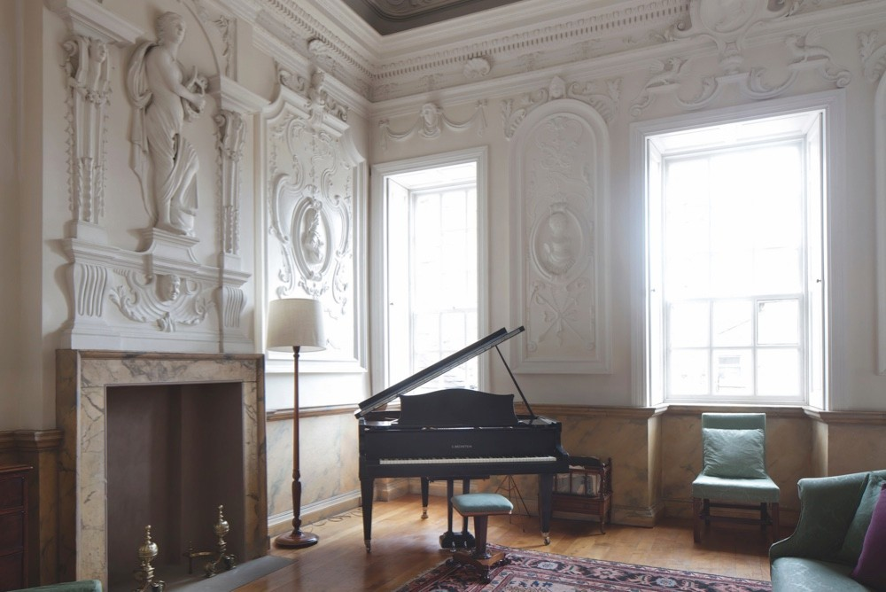 A baby grand piano in a restored Baroque garden pavillion