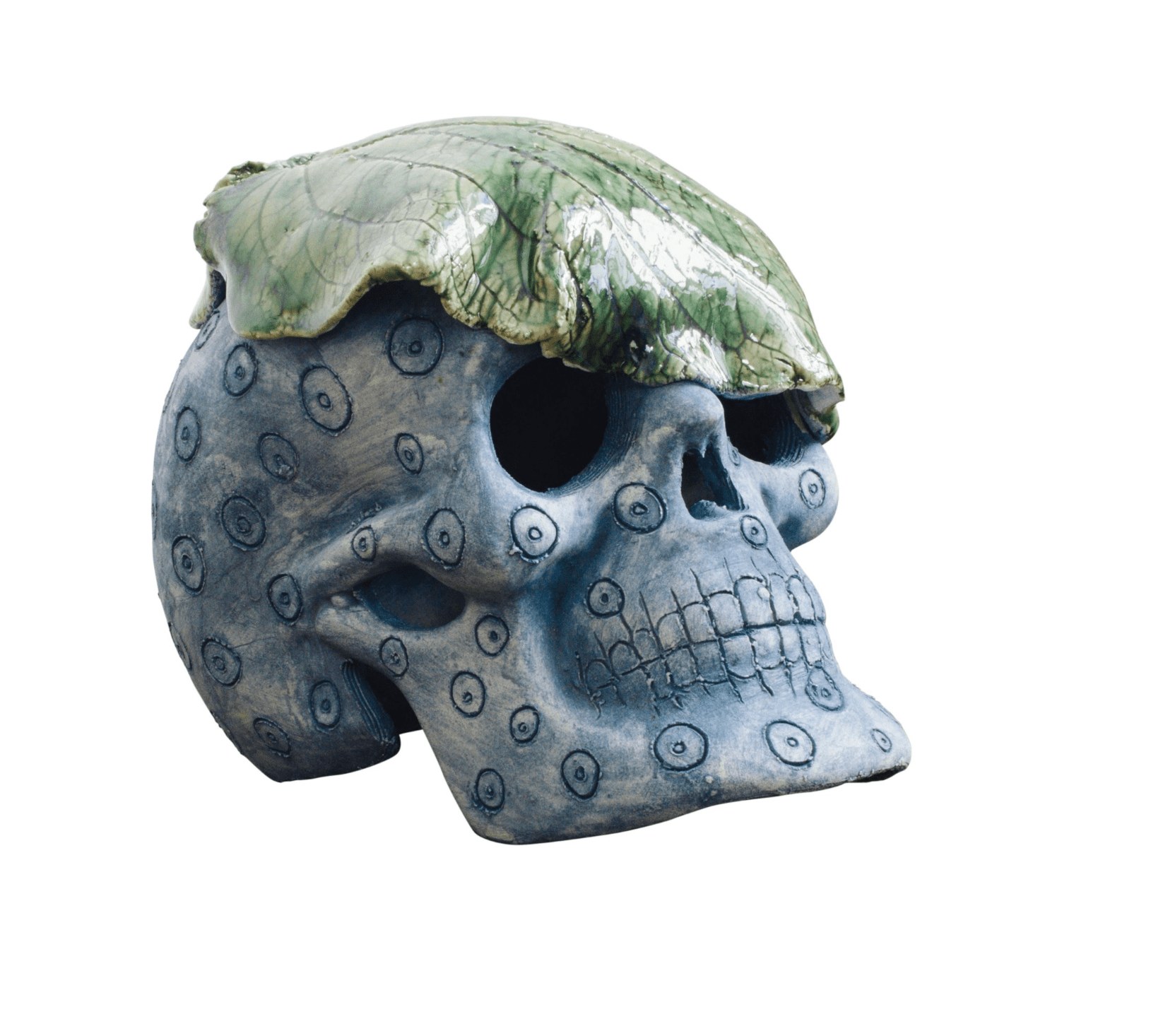 Antique blue and green ceramic skull with cabbage leaf