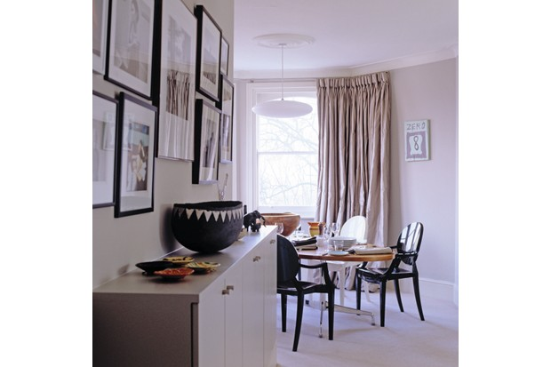 View of a sideboard and dining table in contemporary London apartment. Image shot 02/2005. Exact date unknown.
