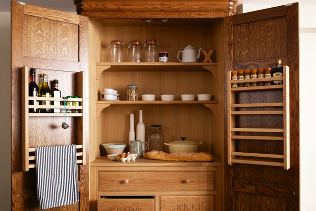 An image of a larder, stocked with preserves and ceramics