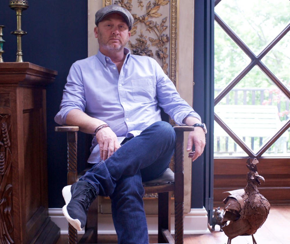 A portrait of antiques dealer, restoration expert and salvage hunter Drew Pritchard in his home