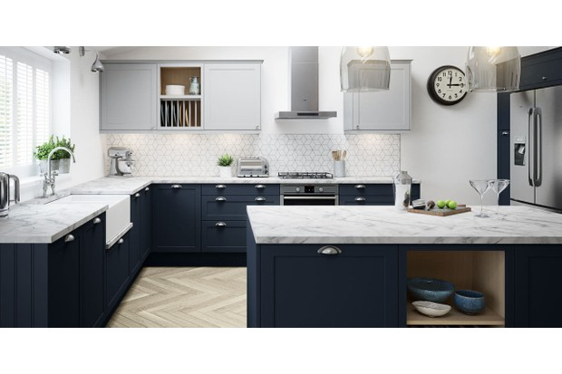 A navy blue shaker kitchen with marble worktops and parquet flooring