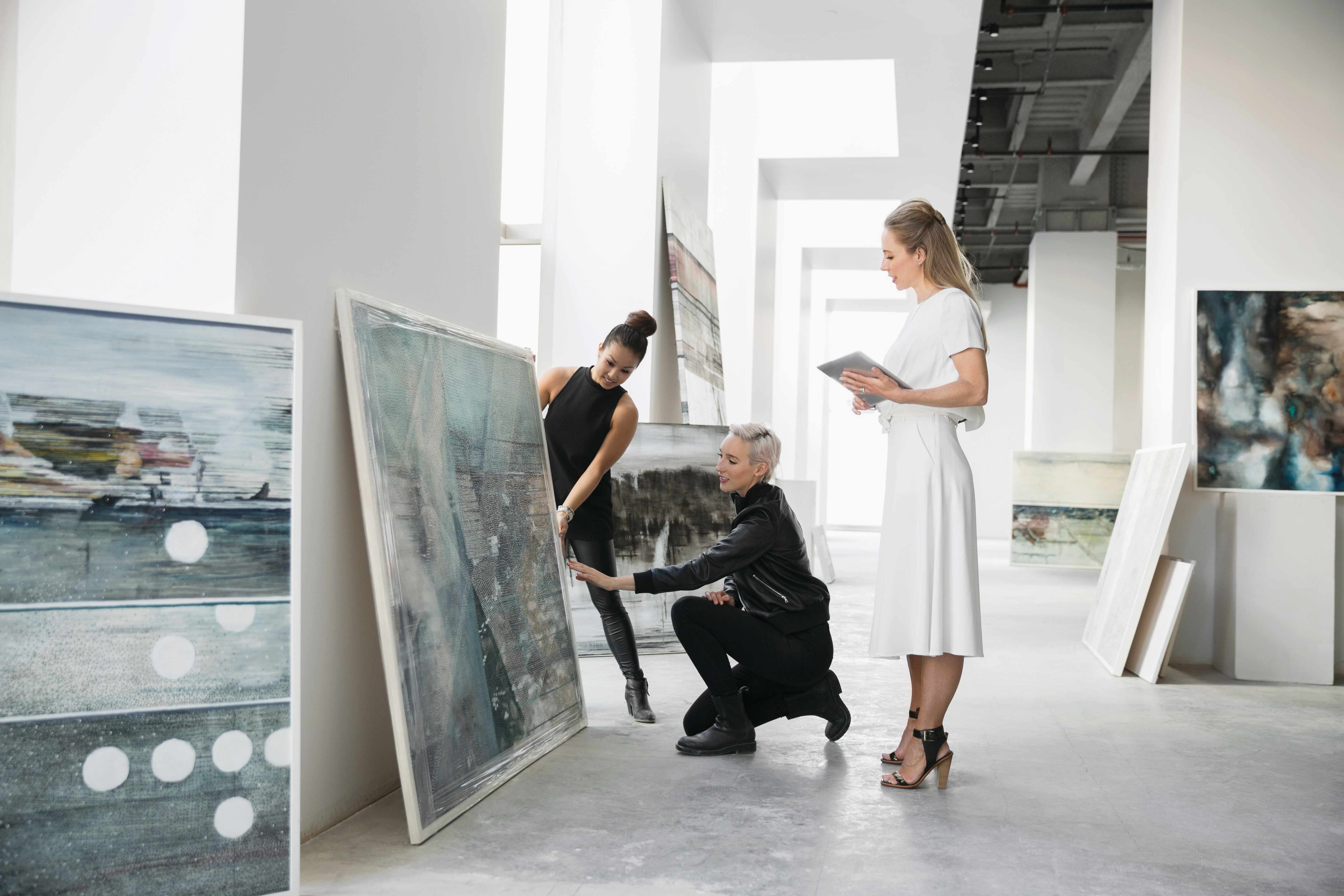 Artist and art dealers discussing paintings