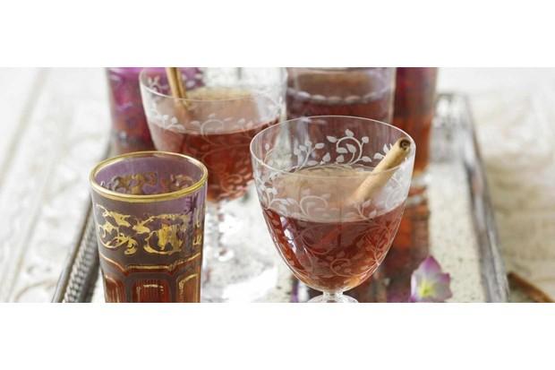 Hot spiced cider cocktails in ornate glasses