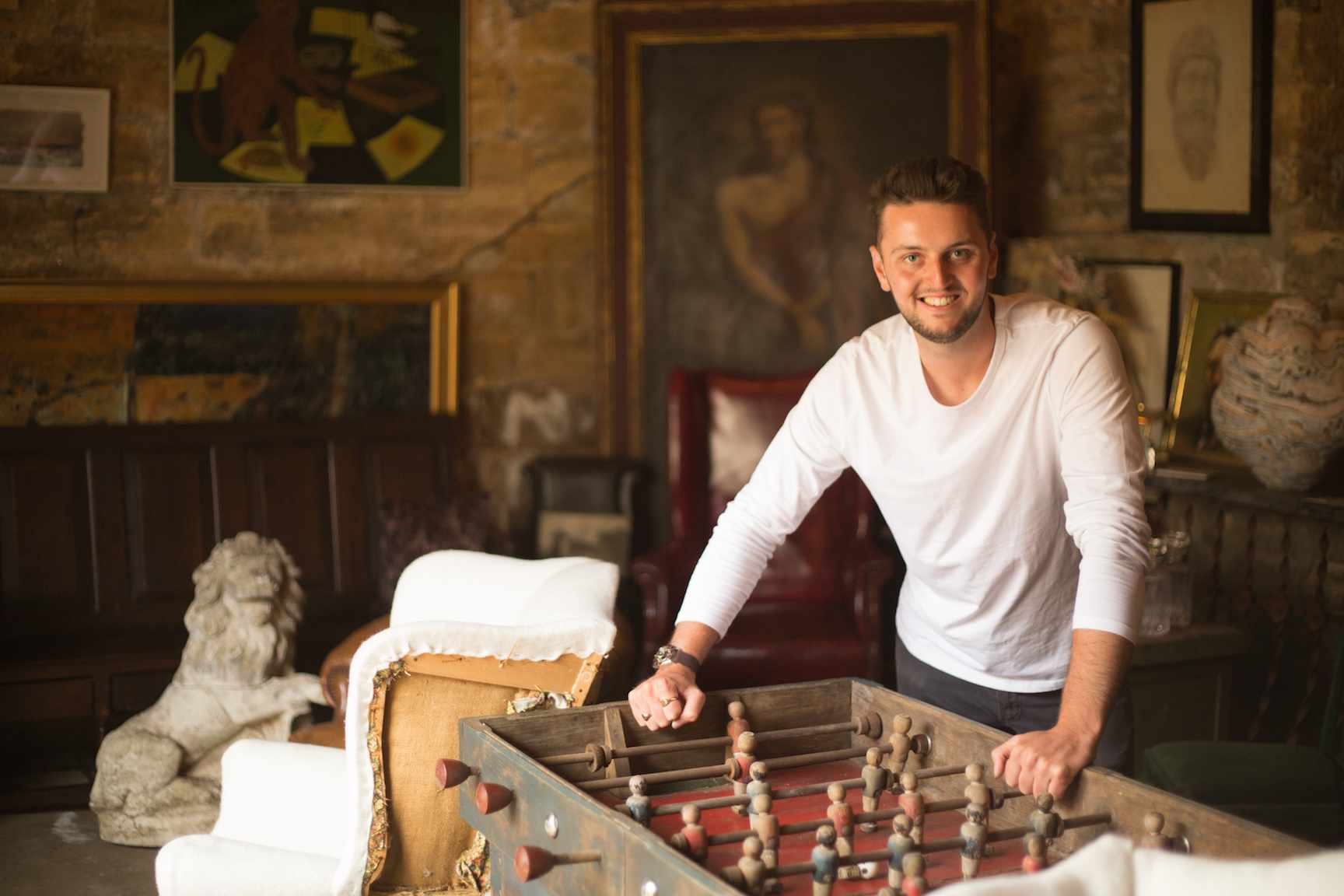 Antiques dealer Max Dixon alongside a vintage football table in his showroom