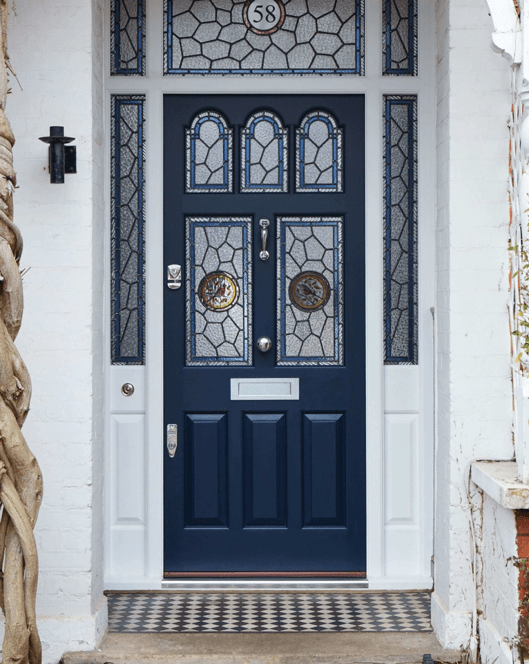 Navy blue front door on a Victorian house