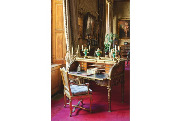 A roll-top desk by Jean-Henri Riesener, situated in the morning room