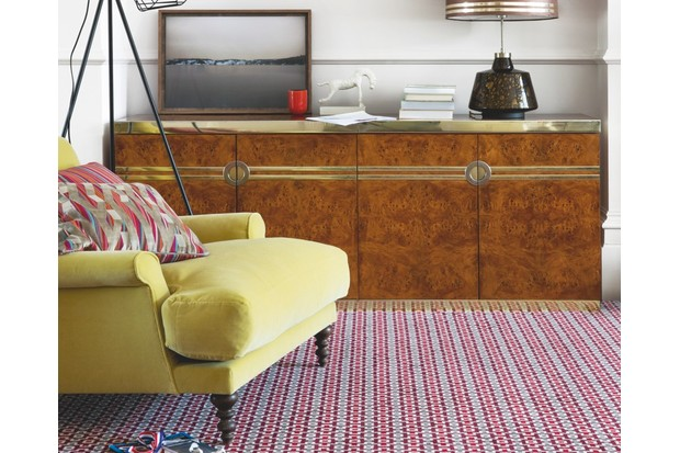 A chair on a carpet with a geometric pattern