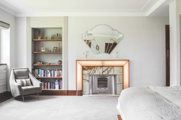 The bedroom of 'Village of Tomorrow' featuring a light-up fireplace