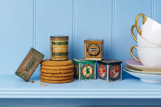 Huntley & Palmers biscuit tins styled on a shelf