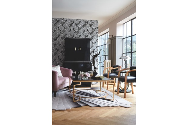 Wallpaper 'Side Car' in 'Onyx' (FP409004), £184 per roll, Pierre Frey. Panelling painted in 'Mole's Breath' Estate Eggshell paint, £55 per 2.5l; walls painted in 'Calamine' Estate Emulsion paint, £39.50 per 2.5l, both Farrow & Ball. 'Rothley' loveseat sofa in 'Scala Velvet', £999, Marks & Spencer. On loveseat: Cushion covered in 'Desire' (9-7714-091), £166.30 per m, Jab Anstoetz. Lacquered cocktail cabinet, £4,800; Epstein art deco side chairs, £2,450 (for the pair), both Jeroen Markies. 'Brompton' coffee table, £4,766, Decorus. On coffee table: Bronze hoop dancer by Preiss, £425, Regent Antiques. 'Manhattan Geo' bowl, £22, Curious Egg. Match striker, £550, Guinevere. Silver cigarette box by Mappin & Webb, £450, Grays Antiques. Perfume bottle (used as a vase), £850, for set of three, Guinevere. Czechoslovakian stepped wine glasses, £480, Gazelles of Lyndhurst. 'Malachite' coasters, £78 for four, Jonathan Adler. Art deco-style side table, £380, Gazelles of Lyndhurst. On side table: 'Desmo' speed nymph car mascot figure, £395, Jeroen Markies. Lamp, £2,130, The Design Gallery. Wall light, £108, Neptune. 'Harlow' rug by Esti Barnes, £4,488, Top Floor