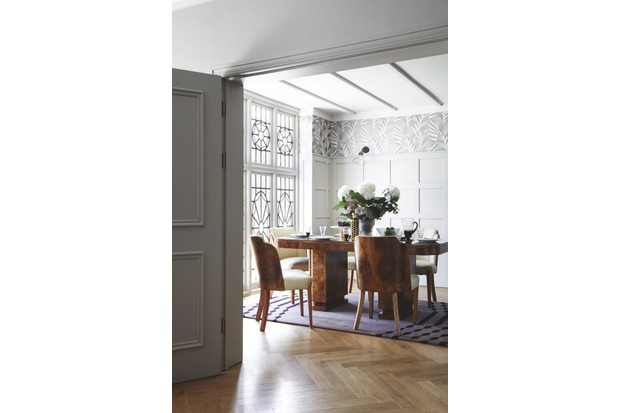 Wallpaper 'Chrysler' (F6862-03), £64 per roll, Osborne & Little. Panelling painted in 'Cornforth White' Estate Emulsion paint, £39.50 per 2.5l, Farrow & Ball. Cloud table and chairs by Epstein, £5,950, Gazelles of Lyndhurst. On table: antique Lalique 'Actinia' vase, £3,350; antique Lalique 'Jaffa' bowl, £485, both Jeroen Markies. 'Nixon' cake stand, £228; 'Newport' decanter, £198, Jonathan Adler. 'Concord Square' dinner plates by Kate Spade, £20 each; side plates by Kate Spade, £20 each, all John Lewis. Czechoslovakian stepped wine glasses with jug, £480, Gazelles of Lyndhurst. Rose gold cutlery 16-piece set, £99, John Lewis. Wall light, £108, Neptune. 'Crawford' rug by Esti Barnes, £2,248, Top Floor