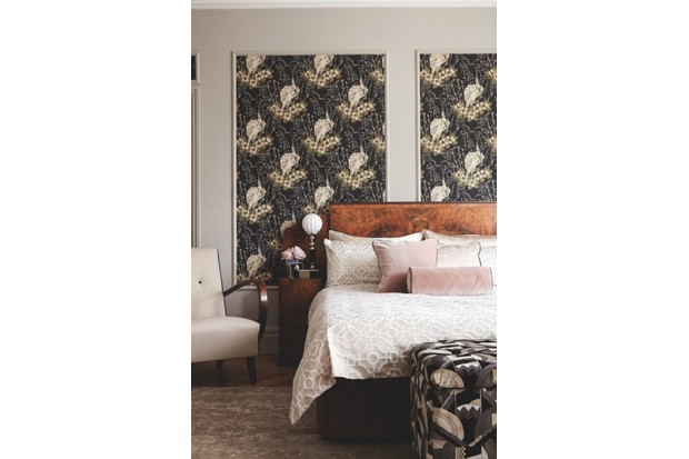 Wallpaper 'The Duke' in 'Panther' (LW057/007), £61.95 per roll, Linwood. Walls painted in 'Purbeck Stone' Estate Emulsion paint, £39.50 per 2.5l, Farrow & Ball. Headboard with bedside cabinets by Epstein, £1,900, The Design Gallery. 'Primrose' double divan bed base in Linwood 'Omega' velvet in 'Brass', £995; mattress, £545, both Button & Sprung. On bed: 'Portico' duvet cover and two pillows, £90, Christy. Silk pillows, £55 for two, Soak & Sleep. Square cushion and bolster made in 'Quartz Velvet' in 'Rose' (ZREV331611), £107 per m; piped in 'Birodo' in 'Smoke' (ZEDO332415), £78, both Zoffany. Rear cushion covered in 'Indra' (J895F-07), £57, Jane Churchill. Piped as before. 'Jindrich Halabala' armchair (one of a pair), £1,575 (for a pair), The Old Cinema. 'Desert Sand' rug, £9,056.50, Tufenkian. Ottoman, £185, The Dormy House. Ottoman upholstered in 'Walter' in 'Usine' (F3109001), £220.80 per m, Pierre Frey. On bedside cabinet: antique Lalique 'Cytise' vase, £1,250, Jeroen Markies. Art deco shagreen and tortoiseshell box, £1,500, Guinevere