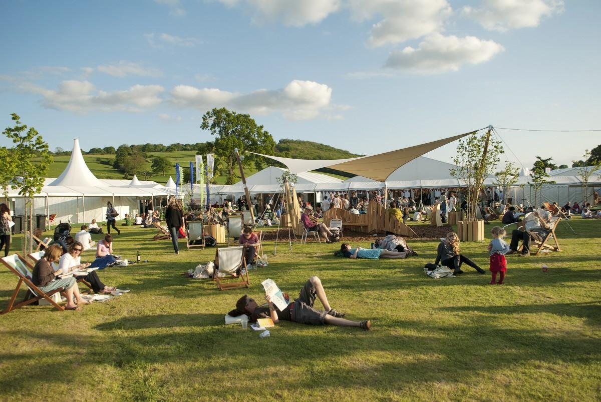 Book lovers enjoying the evening sun at Hay Festival. Credit: Finn Beales