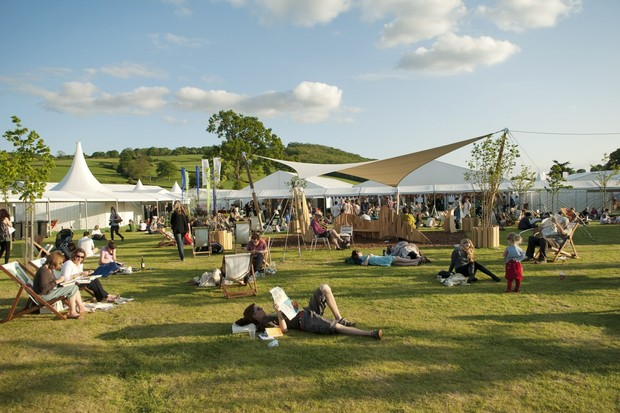 Book lovers enjoying the evening sun at Hay Festival. Credit: Finn Beales