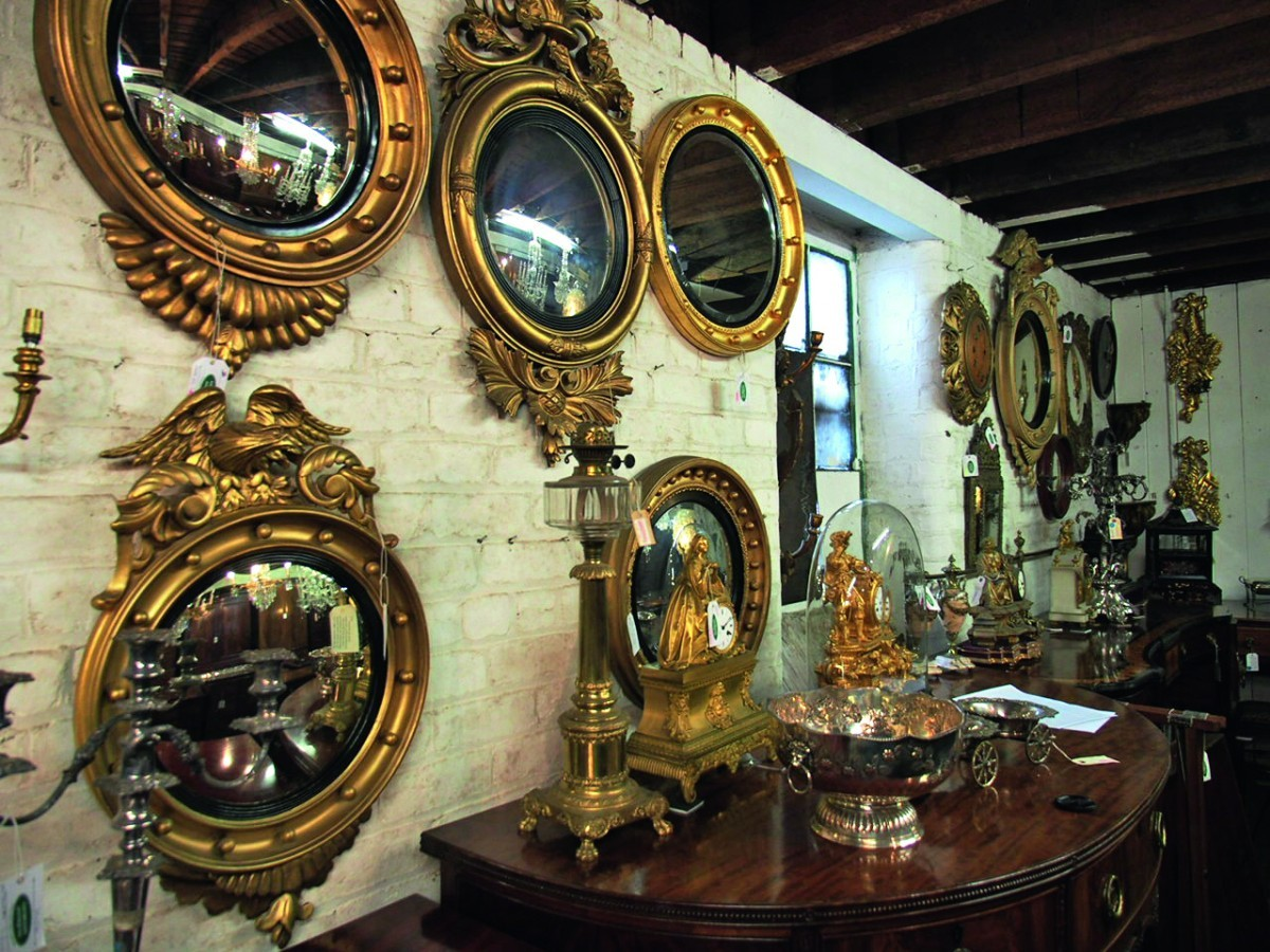 Gilt antique mirrors on a wall